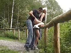 Couple fucks outdoors with a view of the river tubes