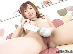 Vibrating her japanese pussy through pink satin panties tubes