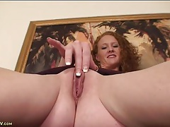 Skinny milf redhead ande plays with her snatch tubes