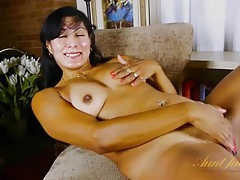 Latina lady with her legs spread as she masturbates tubes