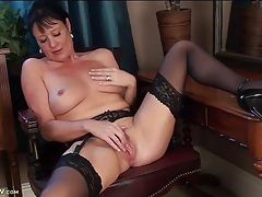 Classy milf beauty in black stockings rubs her hot cunt tubes