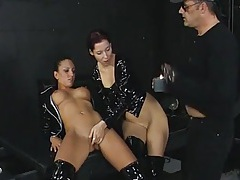Threesome in the dungeon with black latex chicks tubes