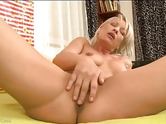 Milf rubs her pussy and perky tits in bed tubes