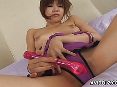 Joyful japanese girl masturbates with her favorite toys tubes
