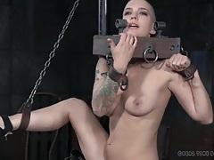 Bald head babe in kinky bondage tubes