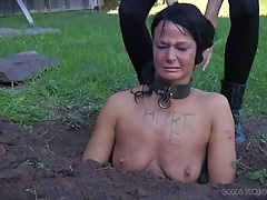 Collared girl buried in the dirt and humiliated tubes