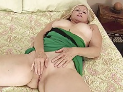 Cute blonde mature babe with big tits rubs her clit tubes