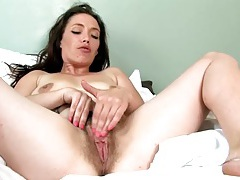 Wicked hairy bush on a solo mom rubbing her cunt tubes