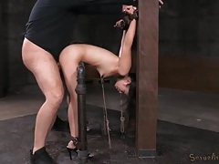 Bent in painful bondage and fucked from behind tubes