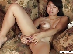 Tattooed solo asian vibrates her hot pussy tubes