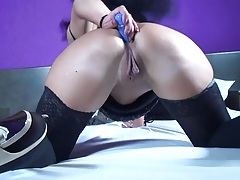 Dildo up the ass of a mature babe in stockings tubes