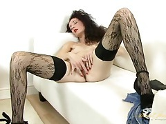 Elegant curly hair milf is stunning in stockings tubes