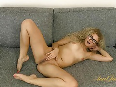 Amateur cutie with curly hair strips and rubs her pussy tubes