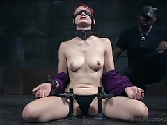Collared and bound redheaded beauty in a dungeon tubes