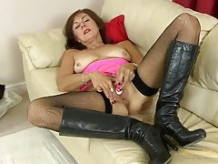 Old lady in sexy leather boots masturbates solo tubes