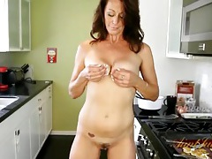 Housewife making pancakes and stripping in the kitchen tubes
