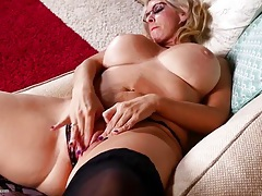 Old hottie rubs her enflamed pink pussy tubes