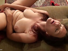 Mature redhead with a toy for her hairy twat tubes