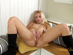 Hot blonde fingers and rubs her pink pussy tubes
