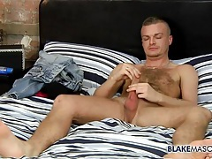 Hairy solo guy sits in bed and jerks off tubes
