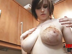 Teen rubs chocolate frosted donuts on her tits tubes