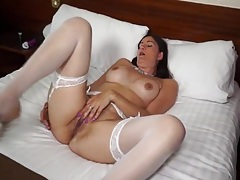 Gorgeous white stockings on a masturbating milf tubes