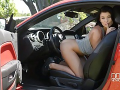 Babe in a sports car plays with her cunt tubes