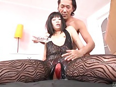 Asian girl in a body stocking coated in slippery oil tubes
