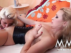 Hot blonde lesbian in a tight corset enjoys a tongue tubes
