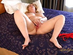 Curvy old lady makes her pussy wet with a vibrator tubes