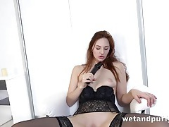 Leggy lingerie babe fucks a long black dildo tubes