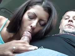 Slutty girl blows and old guy in the car tubes