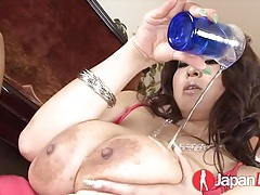 Baby oil coats the body of a busty japanese girl tubes