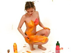 Teen paints her beautiful body lots of colors tubes