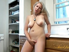 Naked housewife masturbating on her kitchen counter tubes