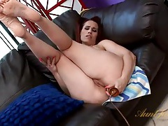 Dirty mommy fucks her asshole with a toy tubes