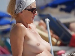 Milf and her perky tits look hot in the sand tubes