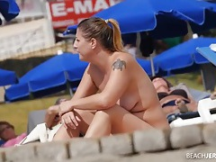Chubby beach babes chatting and smoking tubes