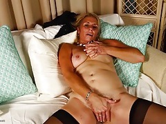 Mature cunt is pink and wet as she spreads her lips tubes