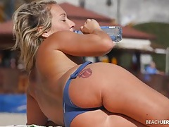 Blue bikini bottoms on a cutie at the beach tubes