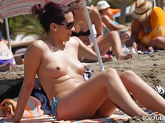 Spying on sexy tits at the beach is fun tubes