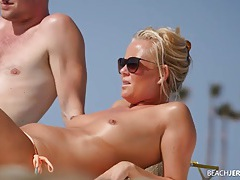 Topless milf works on her tan and gets spied on tubes
