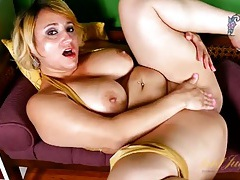 Big titty chick in shiny gold lingerie masturbates tubes