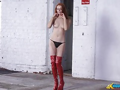 Shiny red latex on a smoking hot redheaded girl tubes