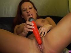Redhead talks filthy as she fucks a dildo tubes