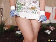 Gardening babe flashes her amazing panties tubes