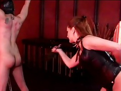 Bound slave abused by a mistress in leather tubes