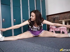 Cheerleader spreads her legs and flashes her cunt tubes