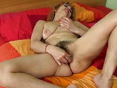 Cock shaped dildo fucks into her hairy cunt tubes