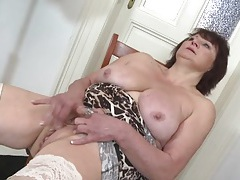 Masturbating granny fondles her big tits tubes